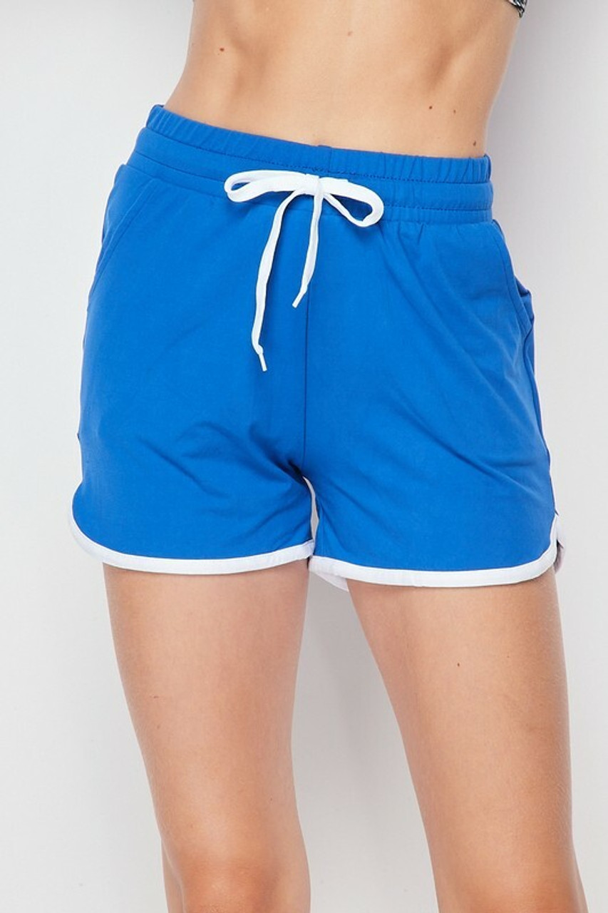 Front side of Blue Buttery Soft Drawstring Waist Plus Size Dolphin Shorts with Pockets
