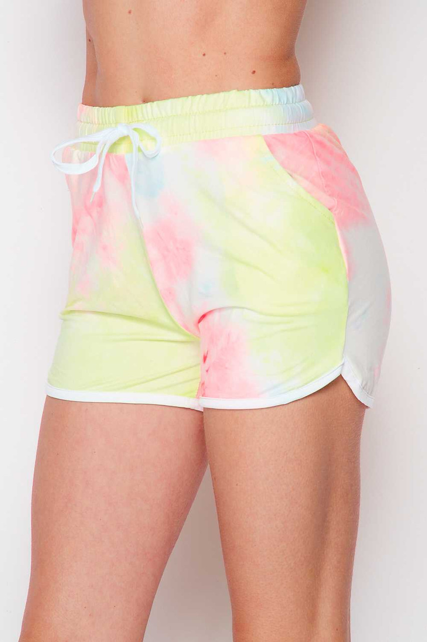 45 degree/right side image of Buttery Soft Pink and Yellow Tie Dye Drawstring Waist Dolphin Shorts with Pockets