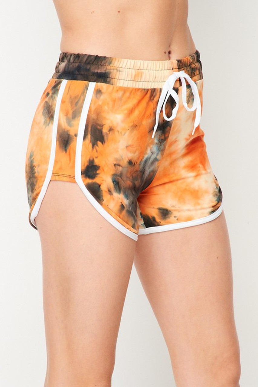 45 degree/right side of Buttery Soft Orange Tie Dye Side Striped Drawstring Waist Dolphin Shorts