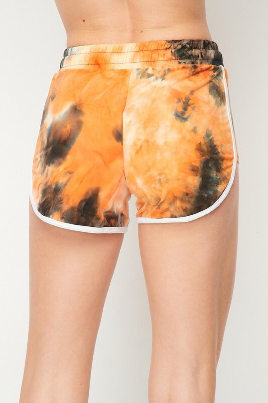 Back side of Buttery Soft Orange Tie Dye Side Striped Drawstring Waist Dolphin Shorts
