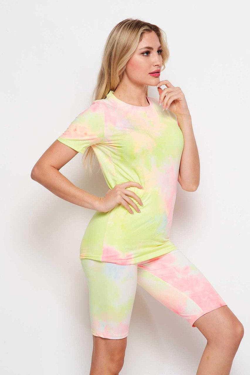 45 degree right side of 2 Piece Buttery Soft Pink and Yellow Tie Dye Biker Shorts and T-Shirt Set