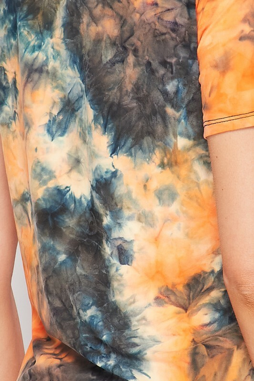 Close-up fabric image of 2 Piece Buttery Soft Orange Tie Dye Biker Shorts and T-Shirt Set - Plus Size