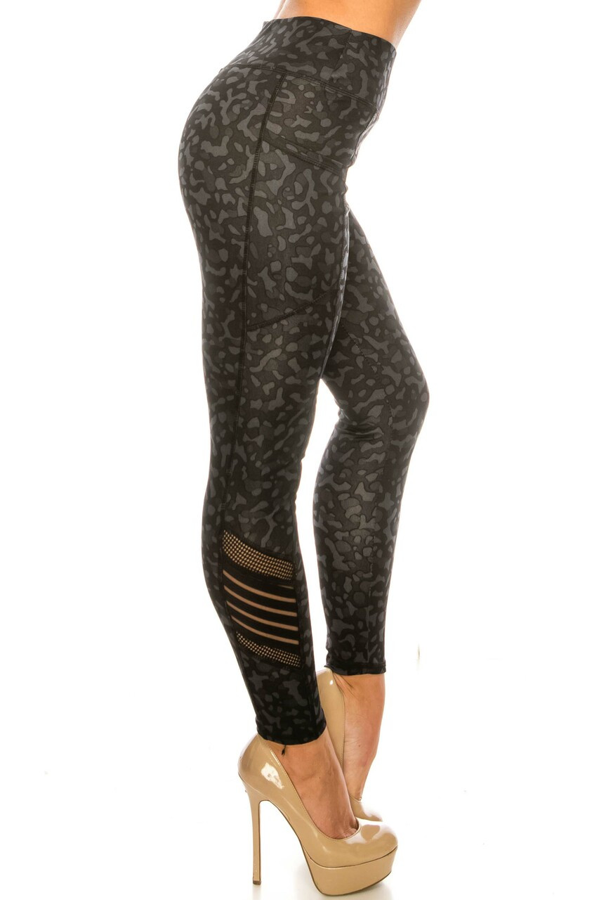 RIght side view of Black Leopard Serrated Mesh High Waisted Sport Leggings showing off the fishnet and striped mesh panel