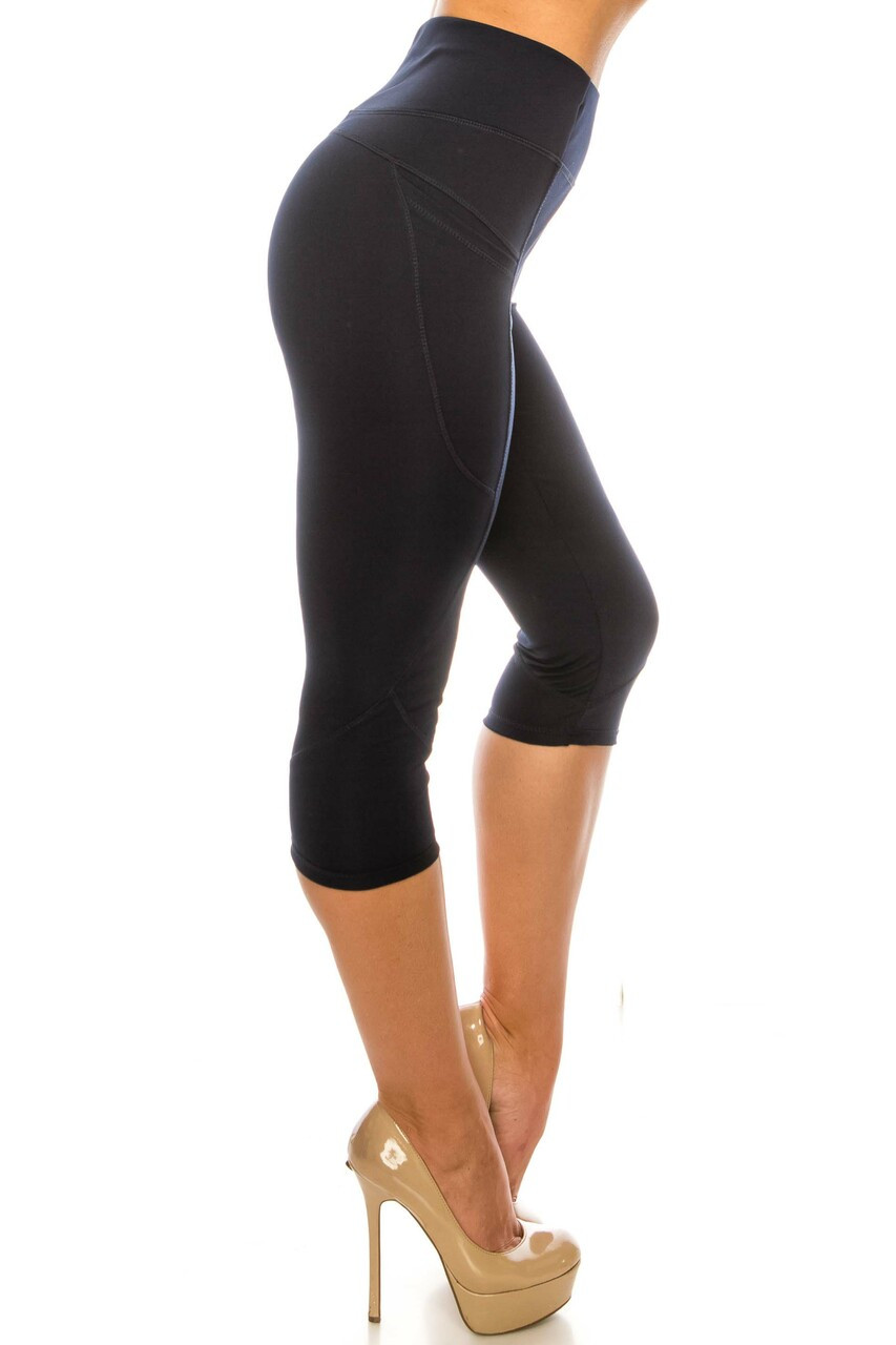Right side image of Navy Contour Seam High Waisted Sport Capris with Pockets made from a durable activewear fabric.