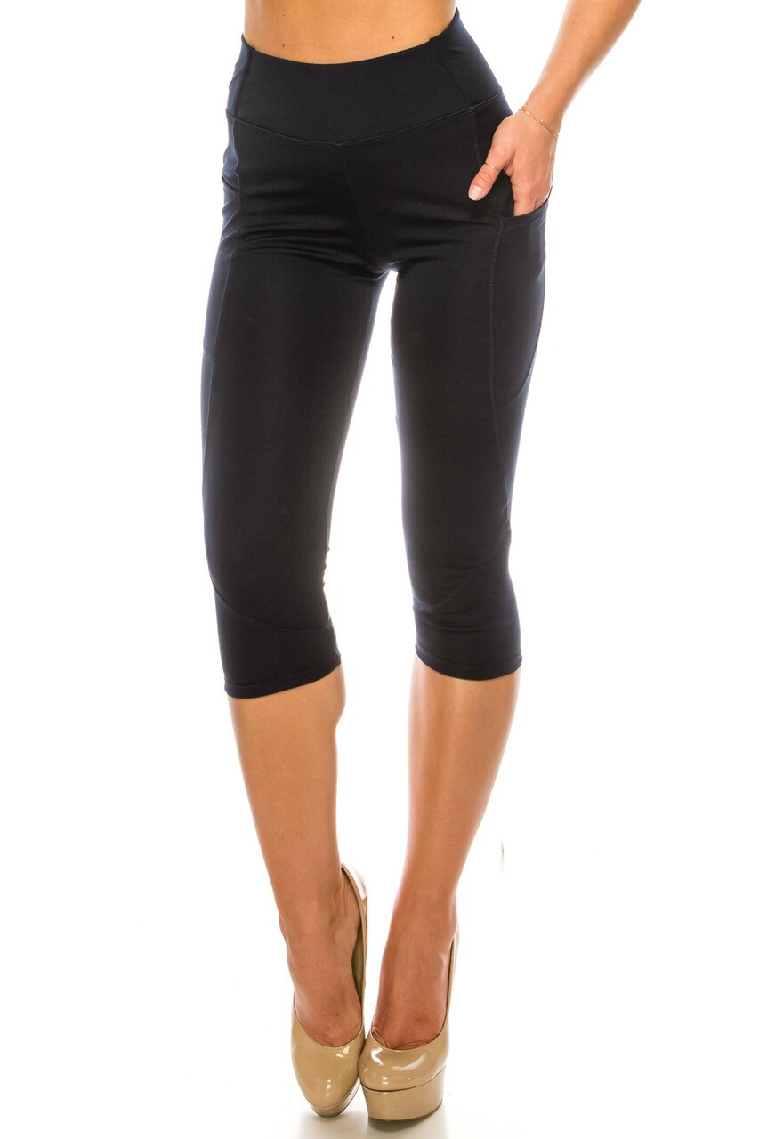Front side view of Navy Contour Seam High Waisted Sport Capris with Pockets with a versatile solid design