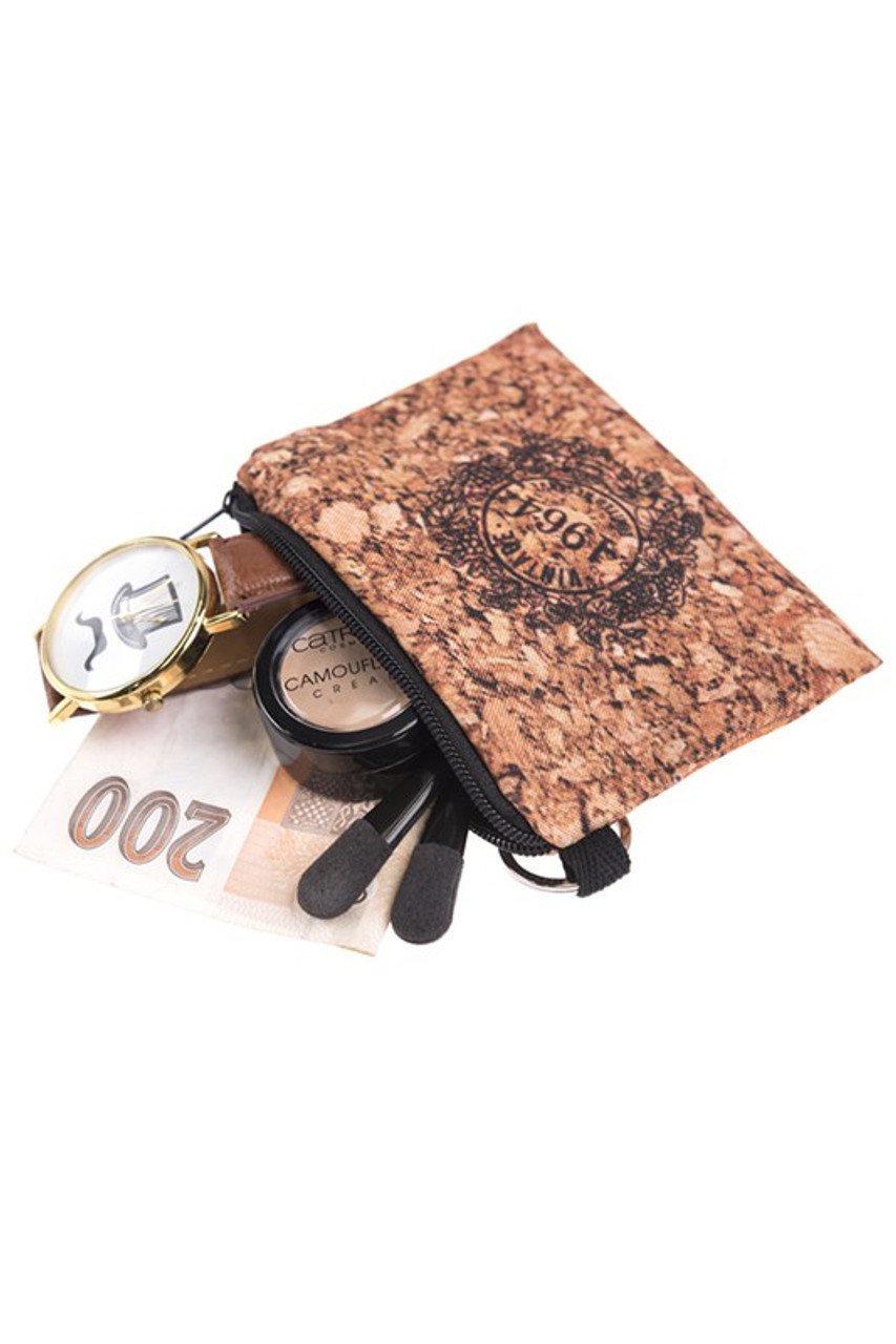 Cork 4964 Graphic Print Coin Purse with cash, makeup brushes, and a watch sticking out