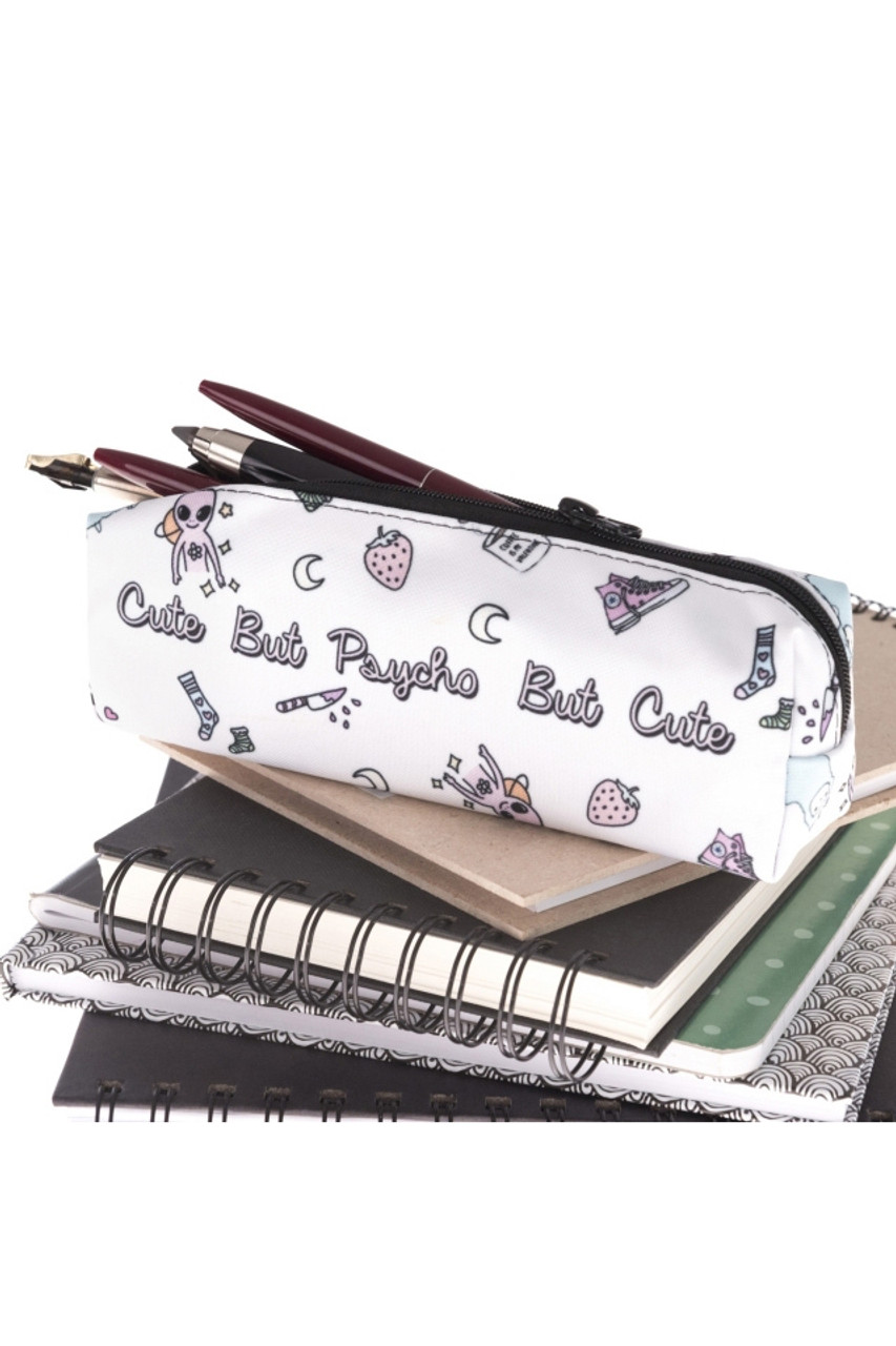 Cute, but Psycho Sassy Text Rectangular Graphic Print Cosmetics Case - 18 Styles shown open with pencils sticking out atop a stack of notebooks.
