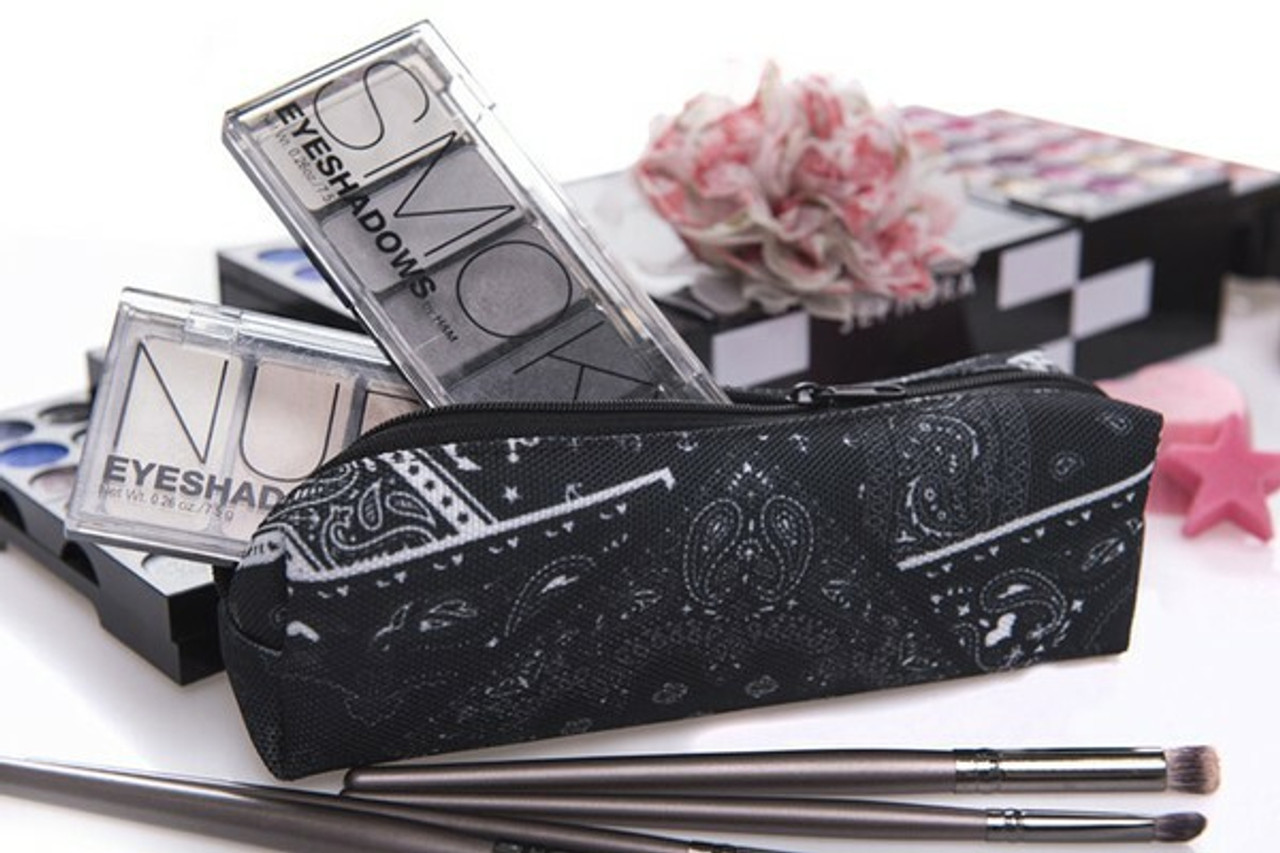 Open view of folded Bandana Rectangular Graphic Print Pencil Cosmetics Case with makeup inside