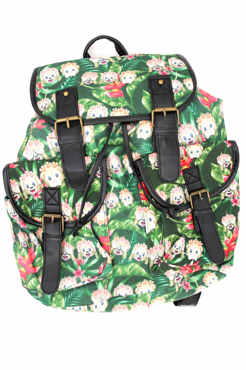 Front of Jungle Monkey Emoji Graphic Print Buckle Flap Backpack with a green leaf and monkey design.