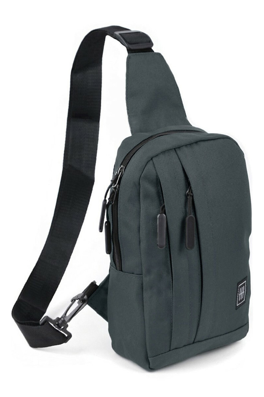 45 degree view of Charcoal Cotton Crossbody Sling Bag with Reversible Strap with to front zipper compartments and a main zip compartment