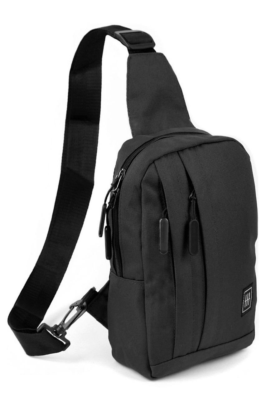 45 degree view of Black Cotton Crossbody Sling Bag with Reversible Strap