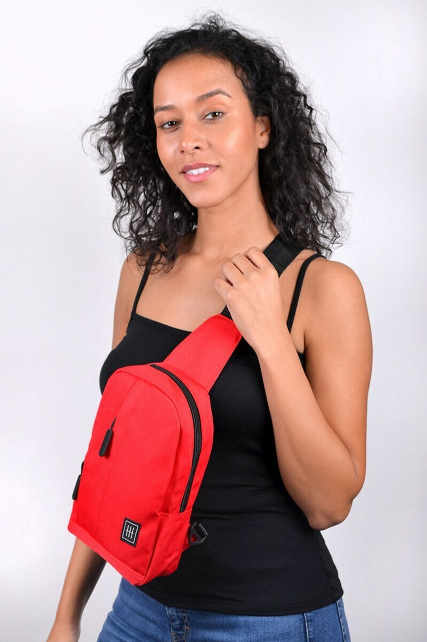 Modeled view of Red Cotton Crossbody Sling Bag with Reversible Strap shown worn on the front