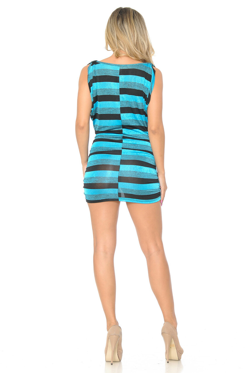 Back side image of Blue Cool Stripes Mini Dress shown styled with nude heels with a black and blue color scheme.