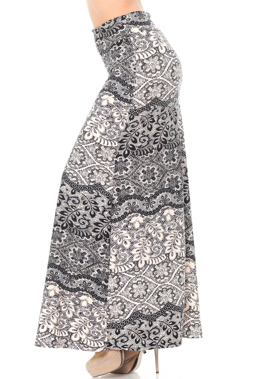 Left side of Buttery Soft Cream Exquisite Leaf Plus Size Maxi Skirt featuring a gorgeous floral design that is perfect for dressy, casual, and professional outfits.
