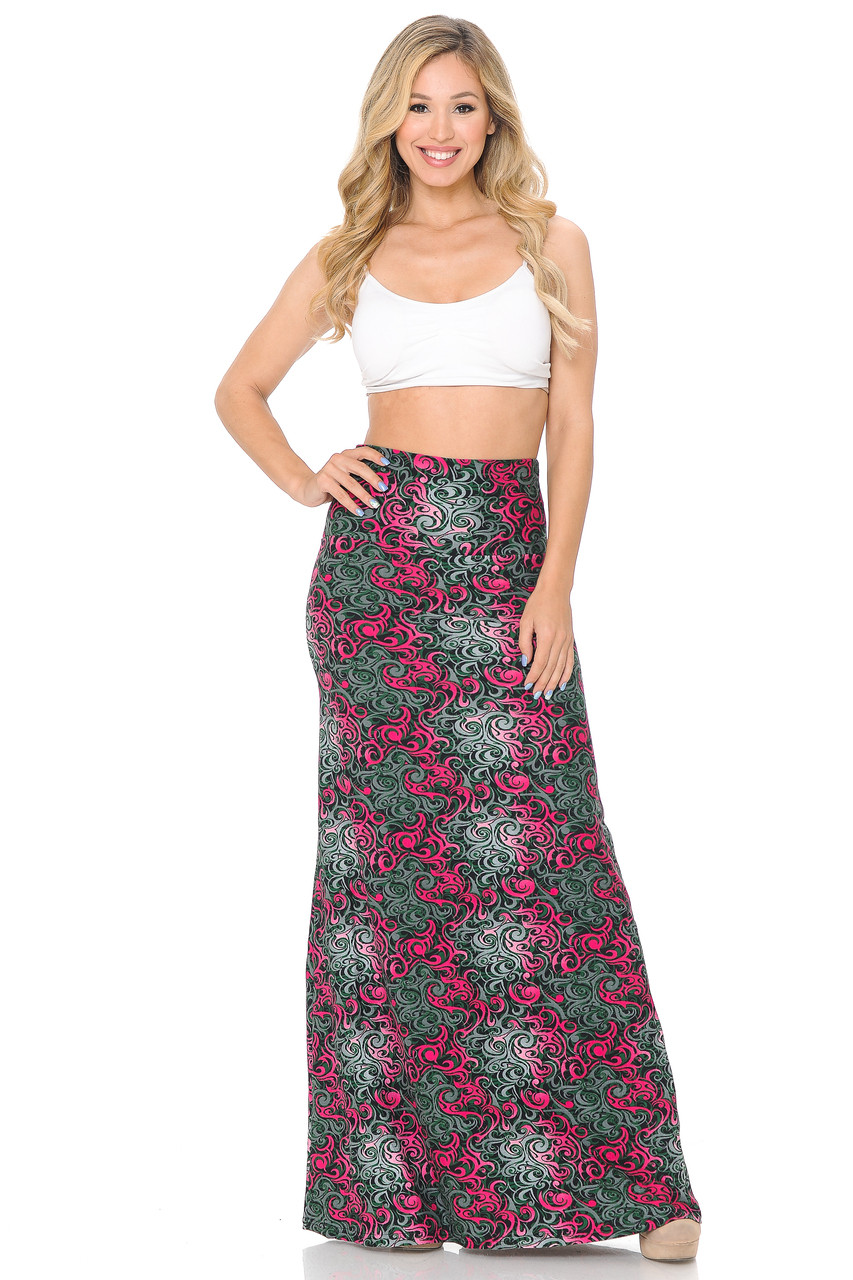 Front side image of Buttery Soft Fuchsia Tangled Swirl Plus Size Maxi Skirt with a flattering high waist design shown paired with a white crop top and nude heels.