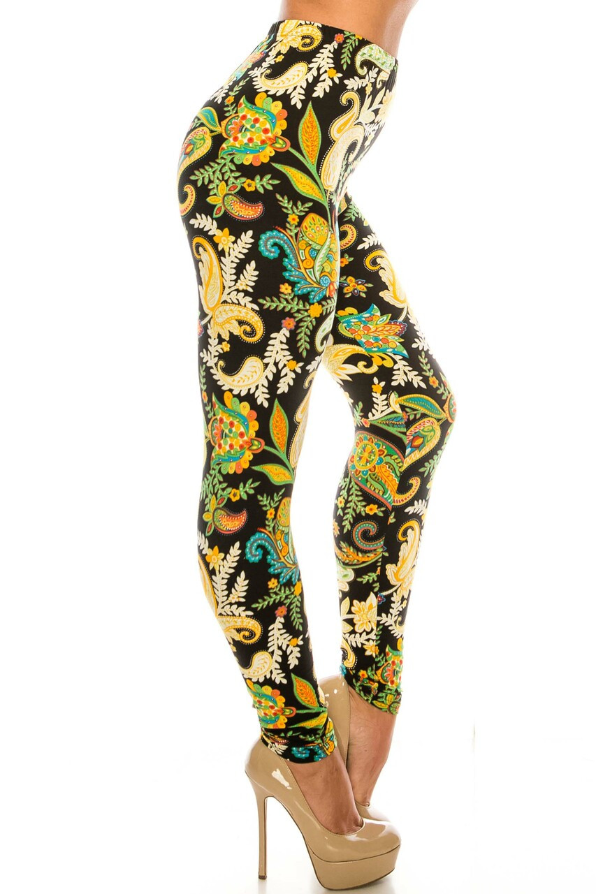 Right side of Buttery Soft Lustered Leaf Plus Size Leggings with a colorful eye-catching design for any season.