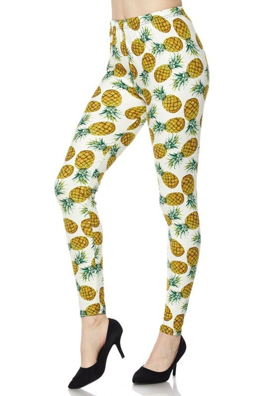 45 degree view of Buttery Soft Ivory Pineapple Plus Size Leggings showcasing a fabulous tropical fruit design.
