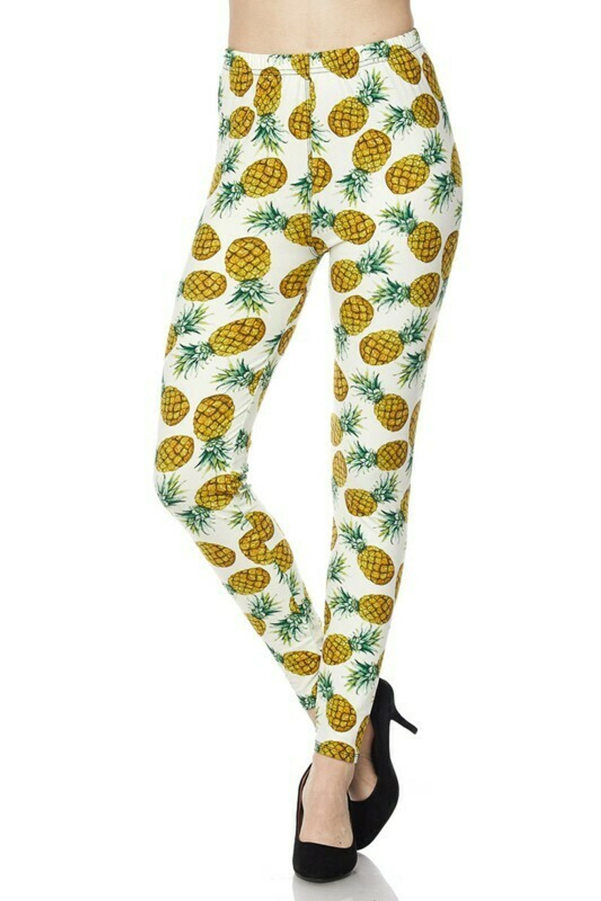 Front side image of Buttery Soft Ivory Pineapple Plus Size Leggings with a mid rise hem.