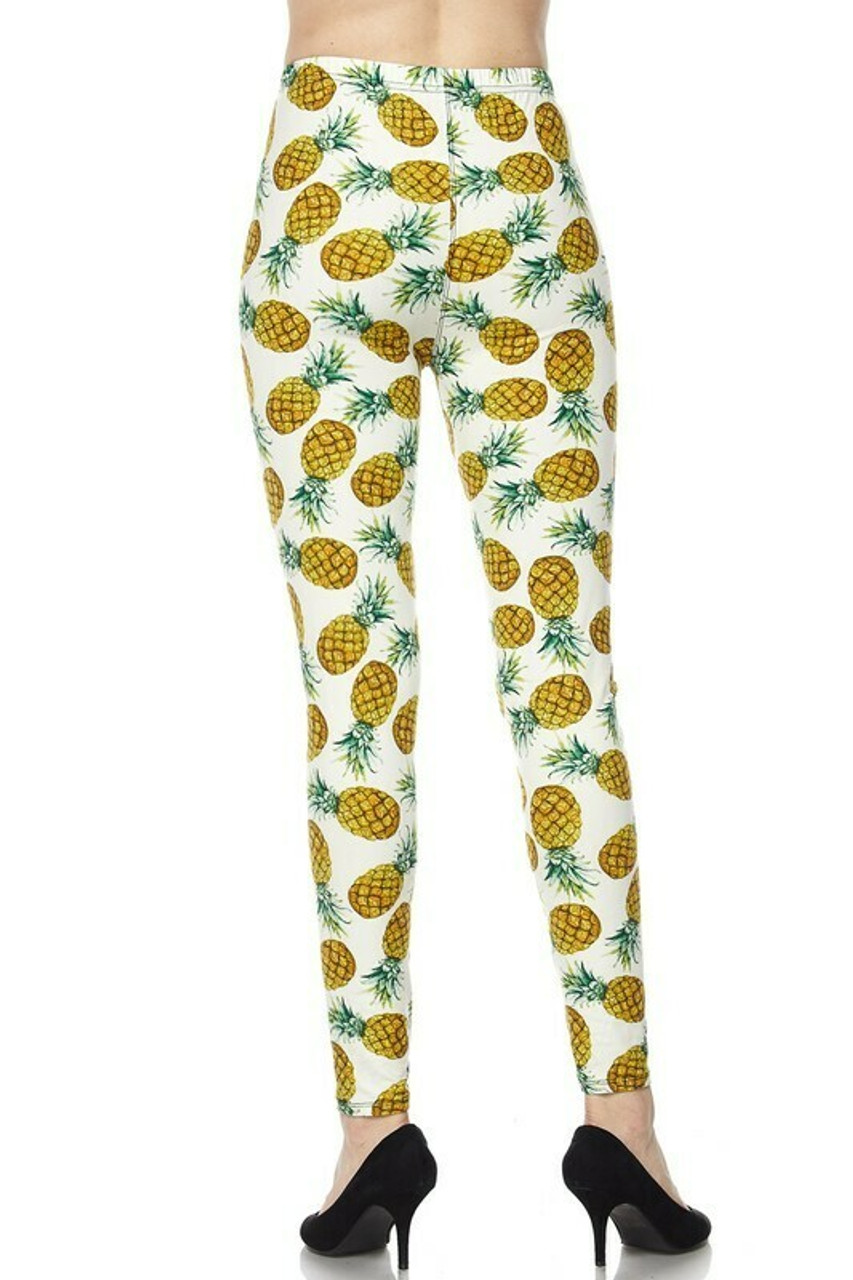 Back side of Buttery Soft Ivory Pineapple Plus Size Leggings with a white, yellow, and green color scheme.