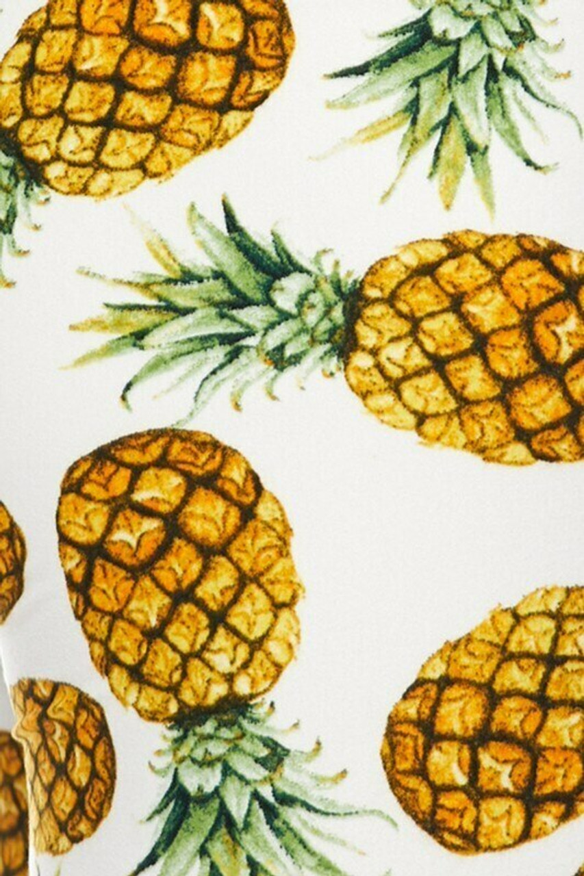 Close-up swatch of Buttery Soft Ivory Pineapple Plus Size Leggings