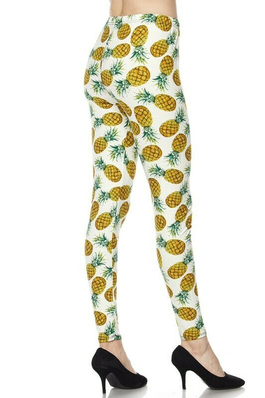 45 degree back/right side of Buttery Soft Ivory Pineapple Plus Size Leggings