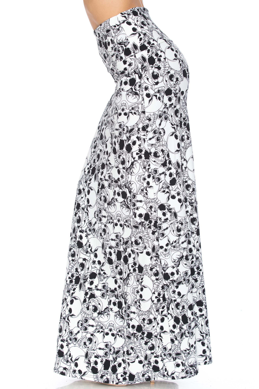 Left side of Buttery Soft White Layers of Skulls Plus Size Maxi Skirt with an all ver edgy skull print ideal for lovers of dark style or the Halloween season.