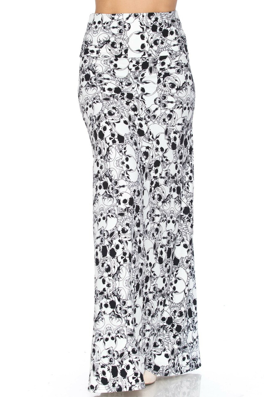Front of Buttery Soft White Layers of Skulls Plus Size Maxi Skirt with a flattering high waist fabric design.