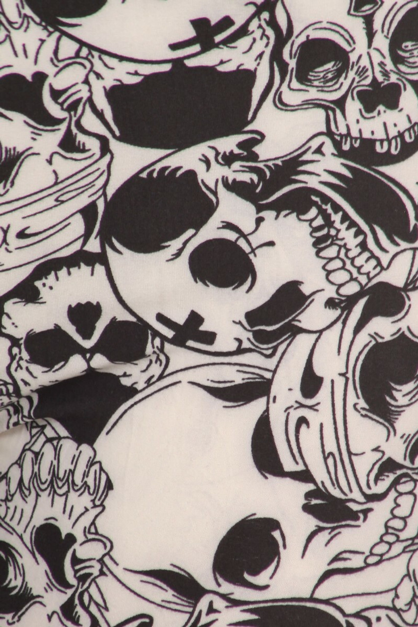 Close-up swatch of Buttery Soft White Layers of Skulls Plus Size Maxi Skirt