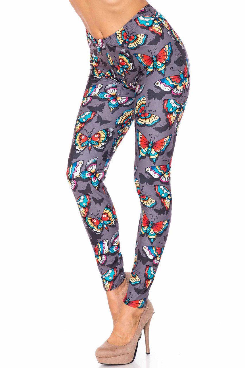 45 degree view of Creamy Soft Jewel Tone Butterfly Extra Plus Size Leggings - 3X-5X - USA Fashion™ with a colorful butterfly design on a charcoal background.