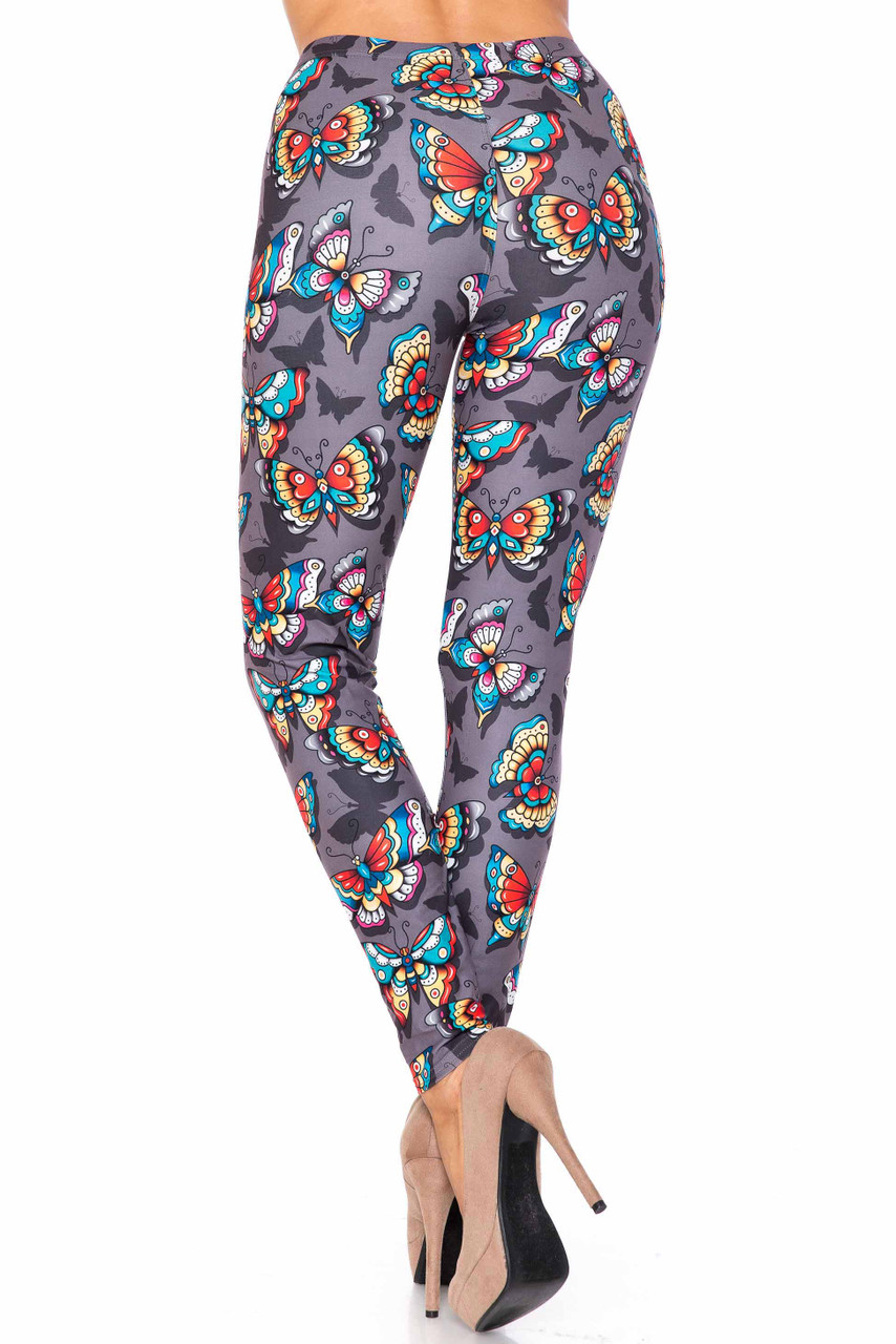 Back side of Creamy Soft Jewel Tone Butterfly Extra Plus Size Leggings - 3X-5X - USA Fashion™ showcasing a body-hugging fit.