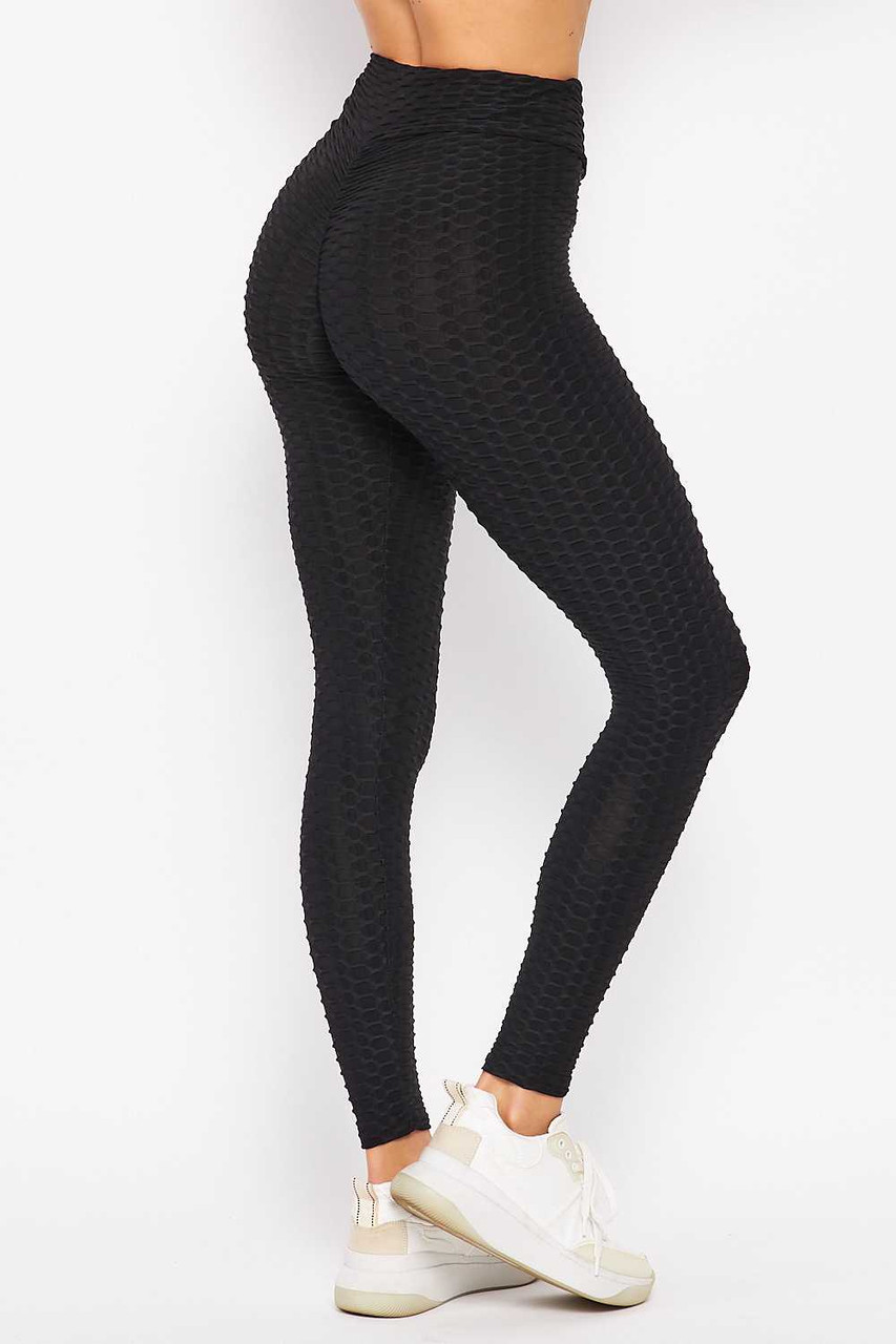 45 degree back right side of black Scrunch Butt Textured V-Waist High Waisted Plus Size Leggings with Pockets