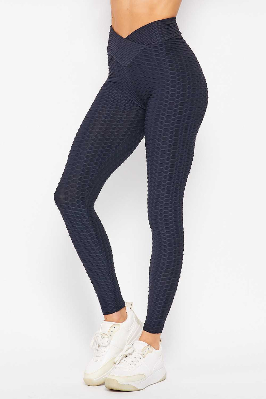 Left side image of Navy Scrunch Butt Textured V-Waist High Waisted Plus Size Leggings with Pockets