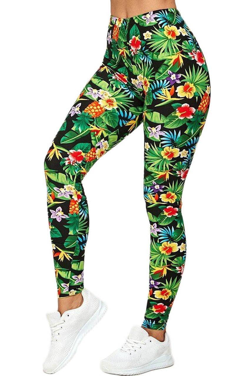 45 degree view of Buttery Soft Tropicana Floral Leggings featuring gorgeous colorful flowers, leaves, and pineapples.