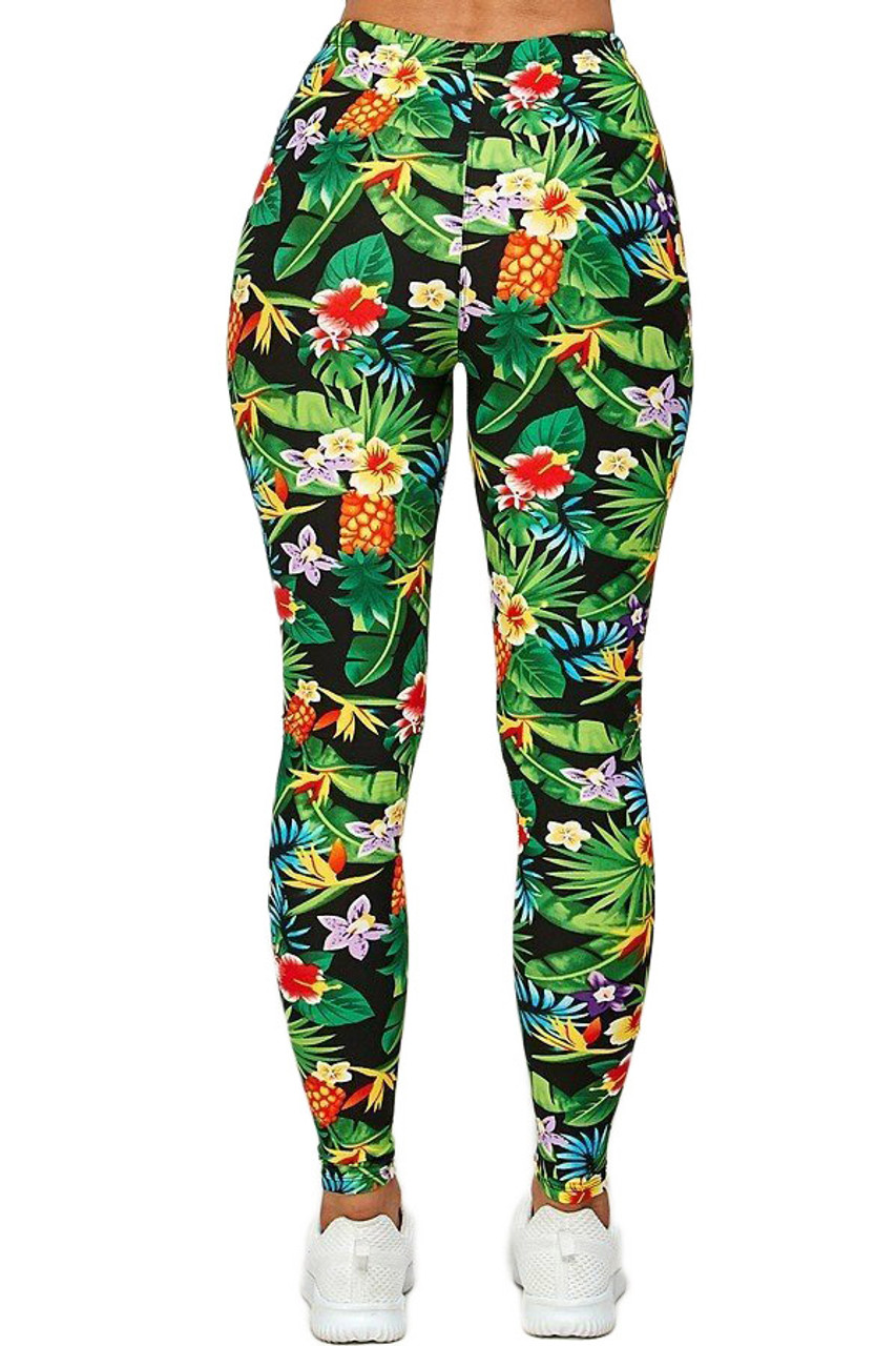 Back side image of Buttery Soft Tropicana Floral Leggings featuring a body-hugging fit and a colorful all over design.