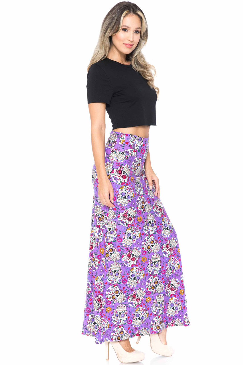 Right side of Buttery Soft Purple Sugar Skull Maxi Skirt shown worn with a black cropped tee and nude heels.