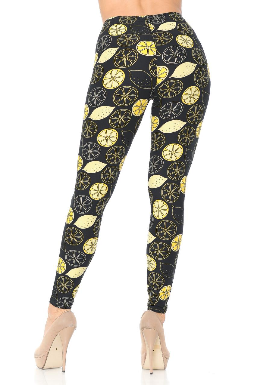 Back side image of Buttery Soft Juicy Summer Lemons Leggings with a figure hugging flattering fit.
