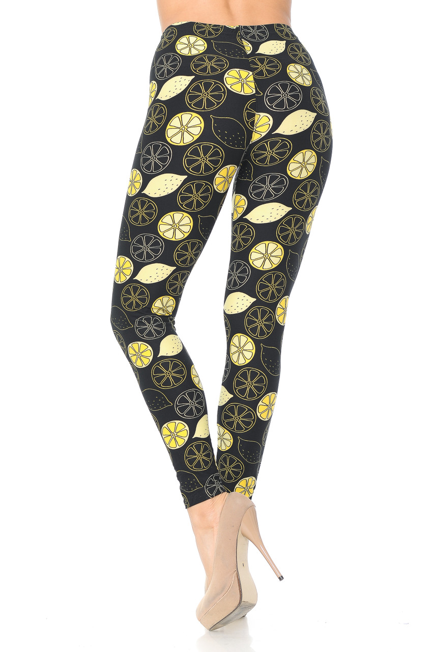 Back side image of Buttery Soft Juicy Summer Lemons Leggings with a fun design for any season.