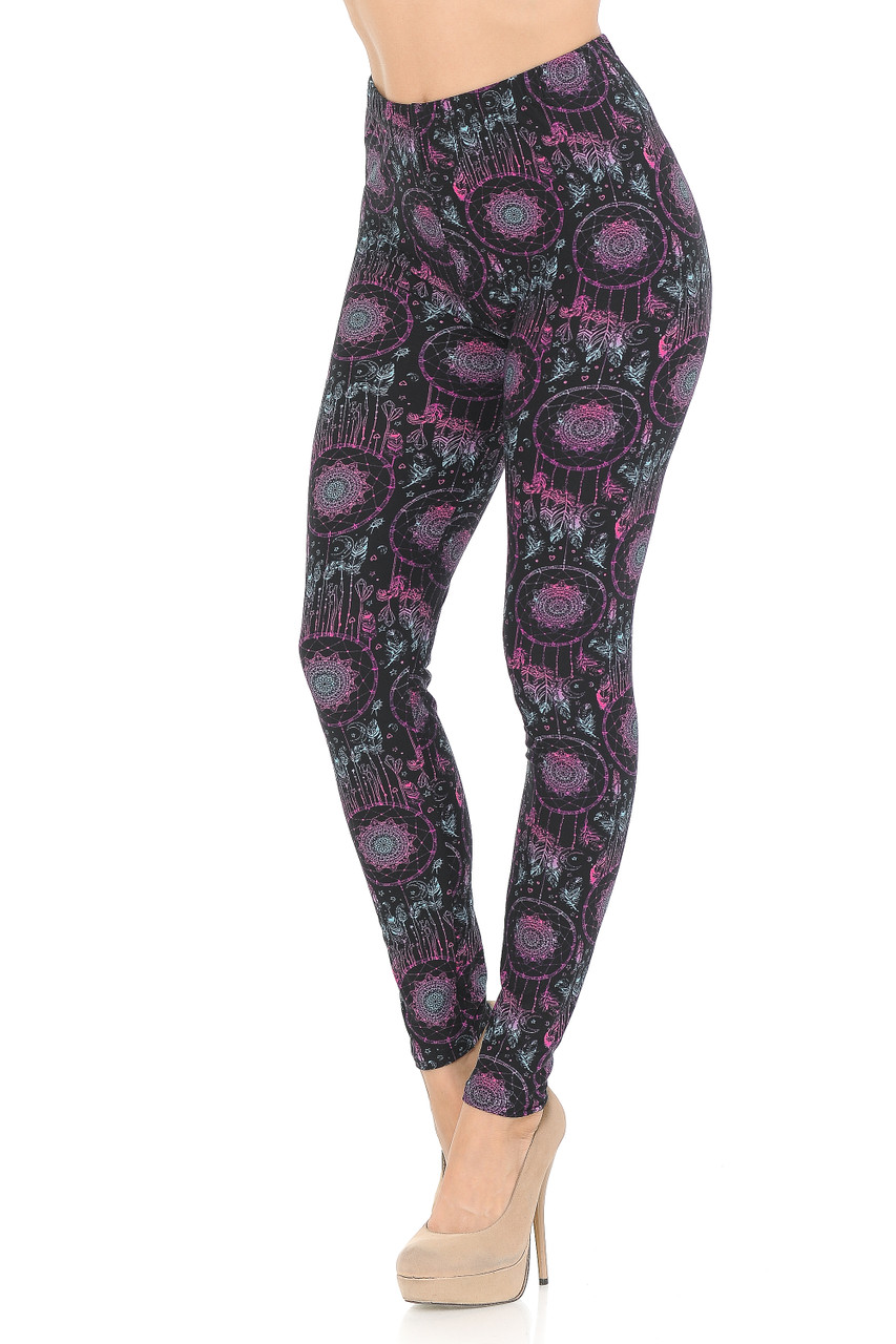 Left side of Vibrant Dreamcatcher Double Brushed Leggings featuring a fabulous pink and blue ombre dreamcatcher print on a black background.