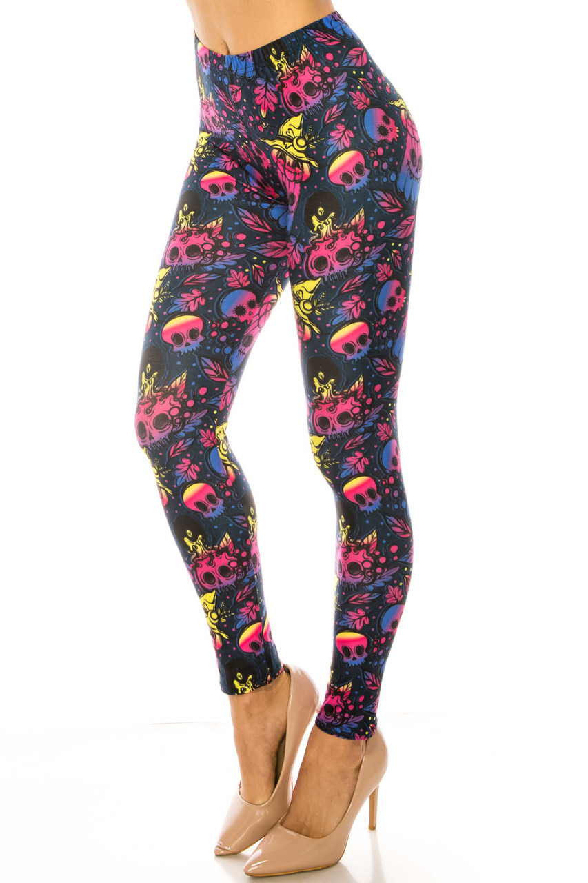 45 degree view of Creamy Soft Autumn Ombre Skulls Plus Size Leggings - USA Fashion™ with a fun and colorful skull design.