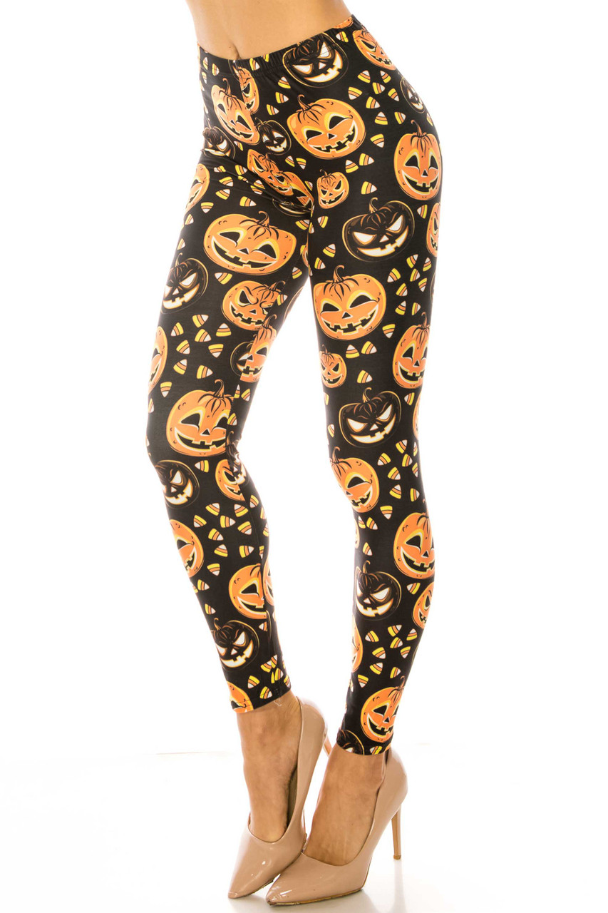 45 degree image of Creamy Soft Halloween Pumpkins Leggings - USA Fashion™ with a festive orange and black jack 'o' lantern design and candy corn accents.