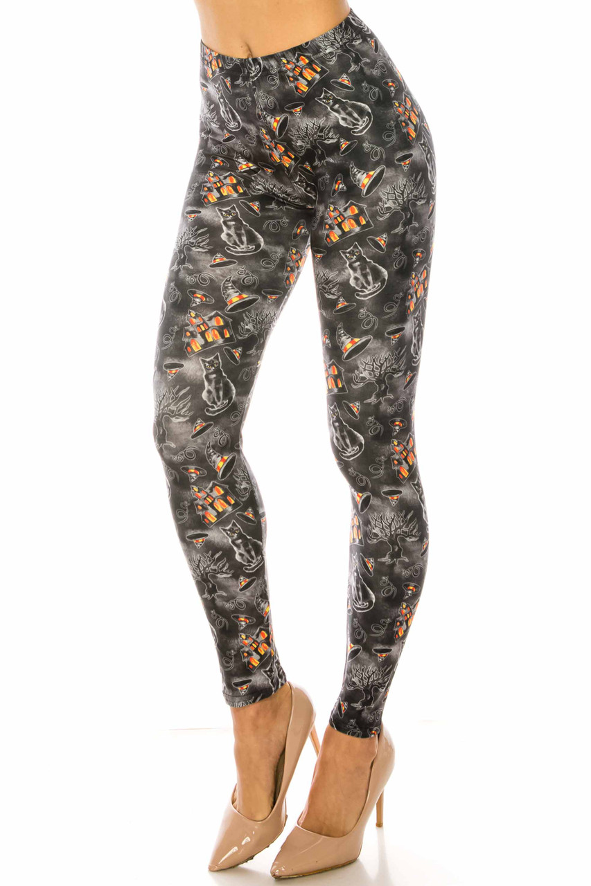 45 degree view of Creamy Soft Haunted Halloween Leggings USA Fashion™ with a spooky house, black cat, and witch hat design.