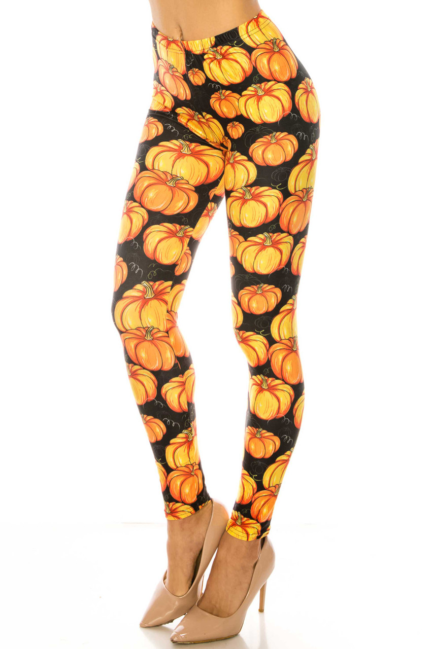 45 degree view of Creamy Soft Autumnal Pumpkins Kids Leggings - USA Fashion™ with a fabulous and vibrant orange on black pumpkin design.