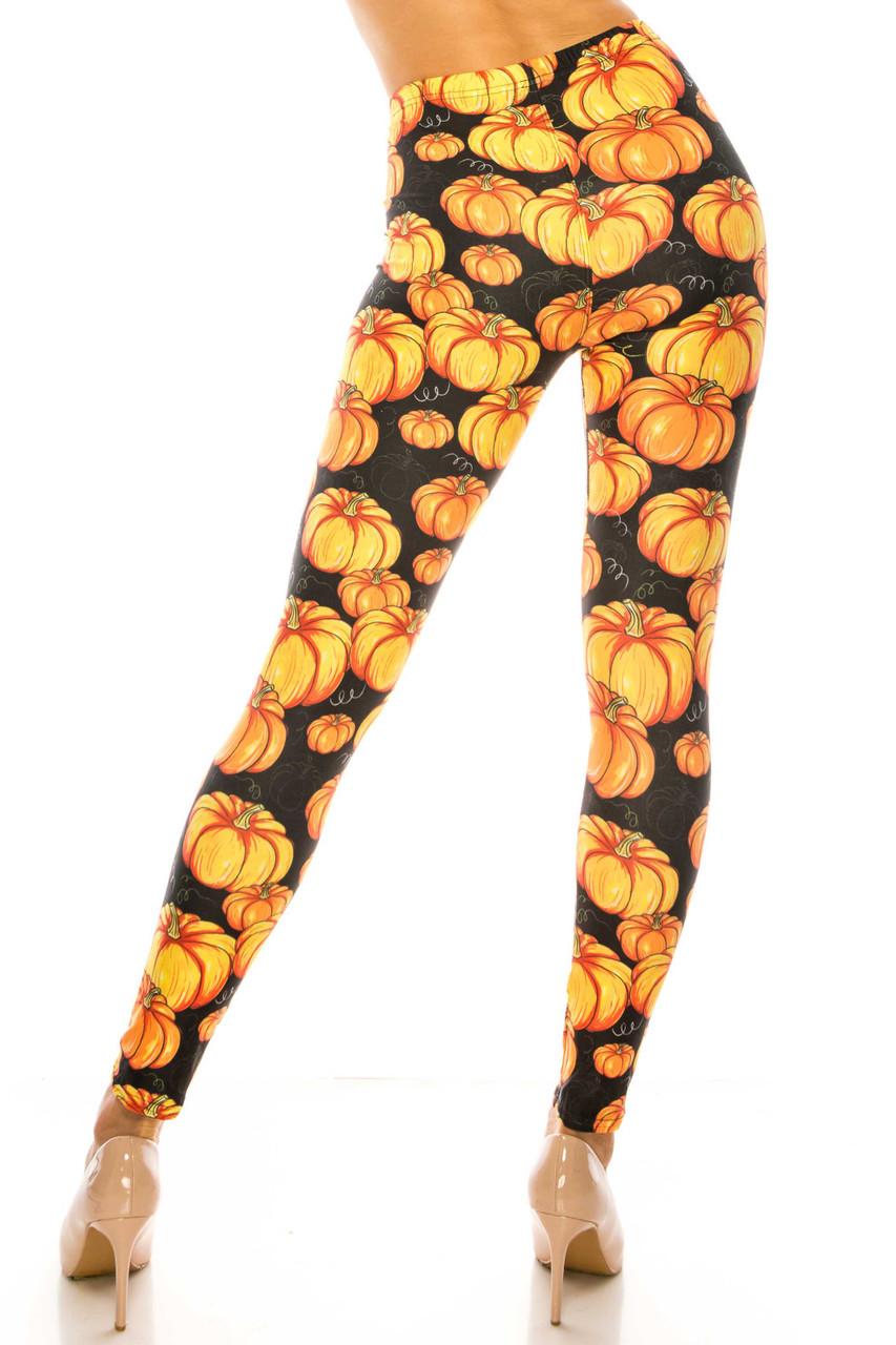 Back side image of Creamy Soft Autumnal Pumpkins Plus Size Leggings - USA Fashion™ with a fabulous festive design.