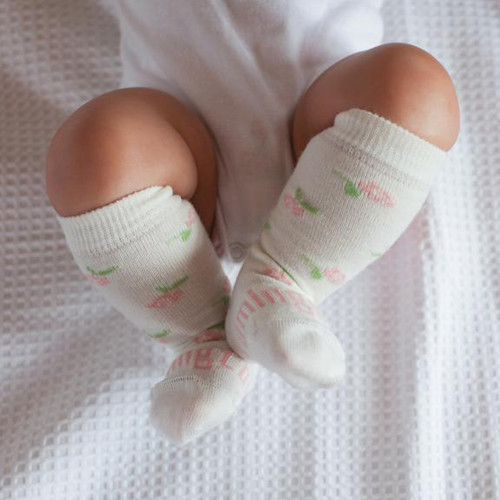 The sweetest little floral knee high merino sock An essential item for every new baby. Merino wool is super soft and cosy on a baby's delicate skin.
