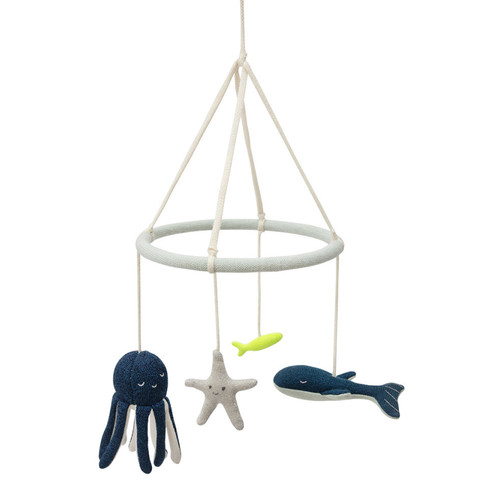 Add a touch of underwater beauty to a little one's room with this gorgeous mobile by Meri Meri. Featuring beautifully crafted sea creatures, made from organic knitted cotton with shimmering thread detail.