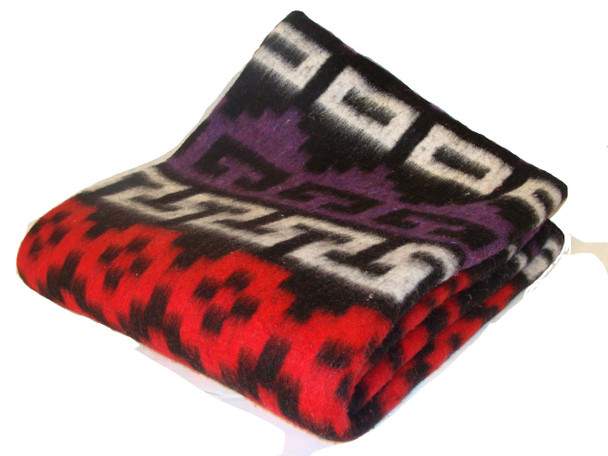 Rugged enough for the campground or living room this  Heritage recycled alpaca/wool blanket provides a generous layer of warmth wherever you need it.