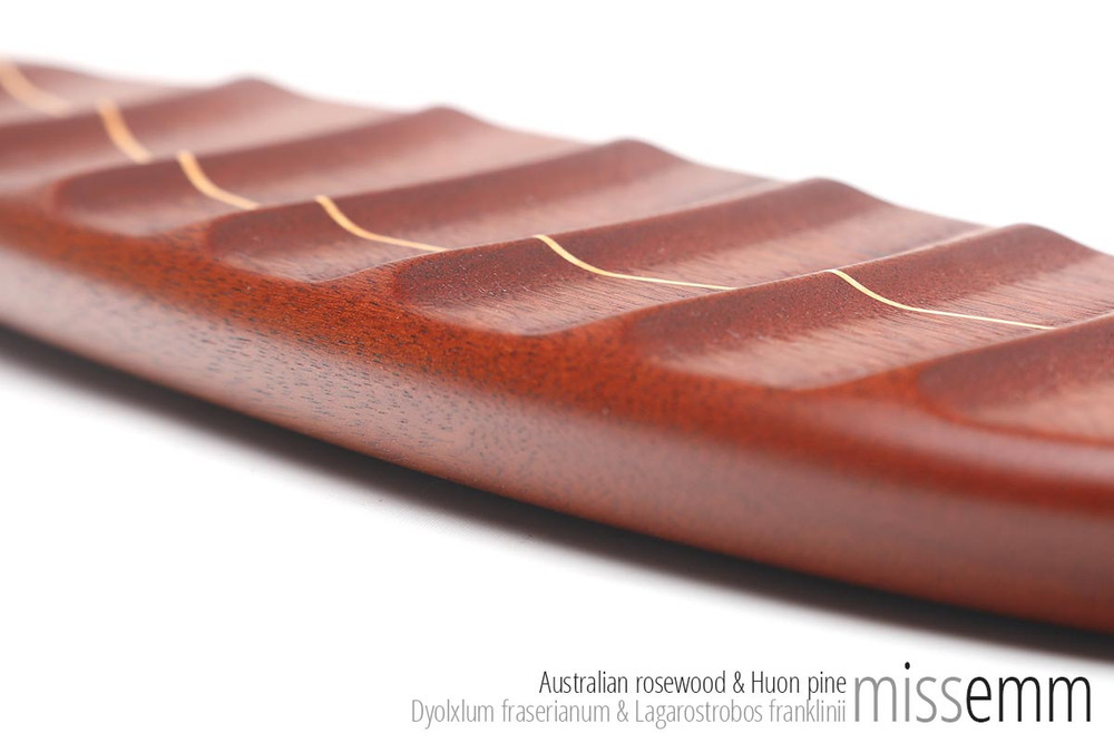 Unique spanking toys   Ridged wooden paddle   By fetish artisan Miss Emm   This stunning spanking paddle is made from Australian rosewood with a Huon pine line and brass details. It has a gently ridged face and a smooth face for adding an extra sensation to your impact play.