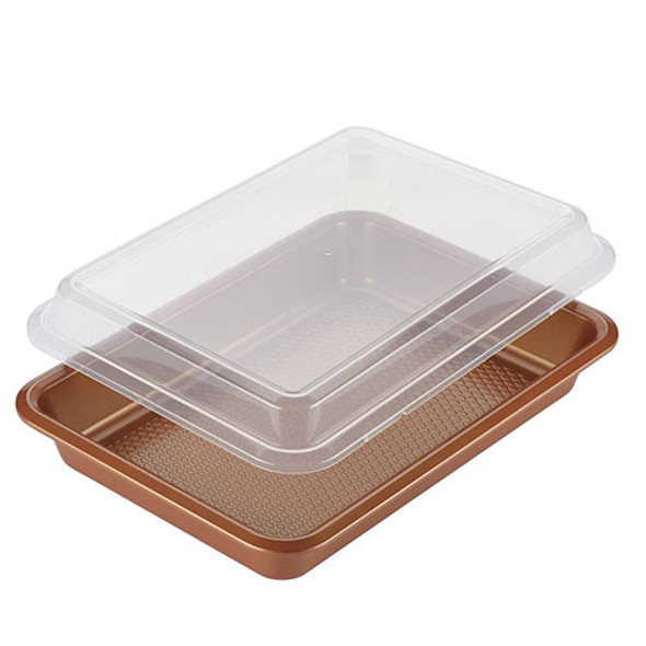 """Ayesha Curry™ 9"""" x 13"""" Cake Pan w/ Plastic Lid in Copper"""