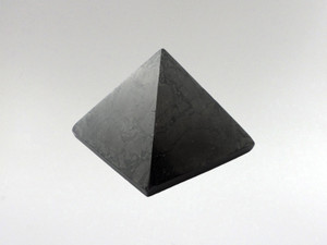 Why keep Shungite in your home? EMF Protection; these days there is a shower of Wi-Fi & electromagnetic frequencies disrupting the energetic field & negatively affecting cells in the body. This creates a feeling of being drained, exhausted & out of balance. Shungite is a powerful protector & has been shown to neutralize electromagnetic radiation. It should be kept in the areas of the home where most time is spent near electronics and internet modems. Having any form of shungite, particularly pyramid or spheres, is reputed to neutralize these frequencies and have a positive impact on health. Shungite has many curative properties & is used for many different reasons ... infuse, ground and stabilize. Water infused with low doses of shungite is said to assist children with hyperactive disorders, assisting to ground them & giving them internal peace. It acts as powerful antioxidant.
