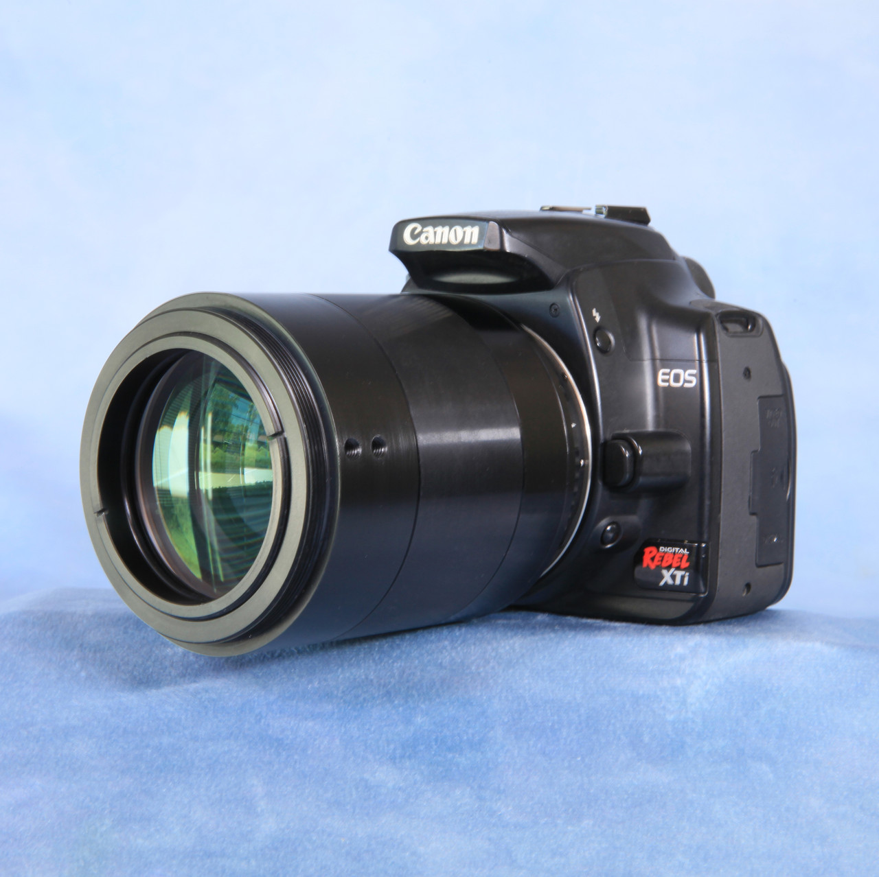 Stellarvue SFFX-1 Photographic Field Flattener attached to a Canon DSLR (camera not included)